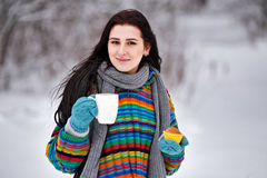 Beautiful young woman in a sweater. Winter outdoors walk with a. Cup of tea Royalty Free Stock Photos