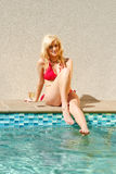 Beautiful young woman by swimming pool Royalty Free Stock Photography