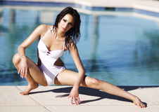 Beautiful young woman beside swimming pool stock image