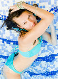 Beautiful Young Woman at the Swimming Pool Royalty Free Stock Photos