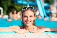Beautiful young woman in the swimming pool Royalty Free Stock Photos
