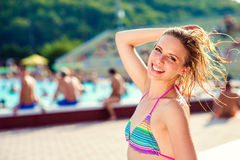 Beautiful young woman in the swimming pool Stock Photography