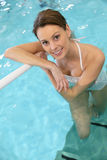 Beautiful young woman in a swimming pool Royalty Free Stock Image