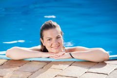 Beautiful young woman in a swimming pool Royalty Free Stock Photo