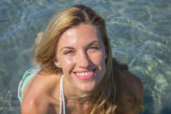 Beautiful young woman swimming in sea, face closeup Royalty Free Stock Photo