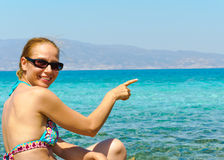 Beautiful young woman in swimsuit, relaxing on a tropical sunny beach Stock Photo