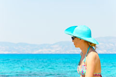 Beautiful young woman in swimsuit, relaxing on a tropical sunny beach Stock Images
