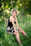 Beautiful young woman on a swing Royalty Free Stock Photos