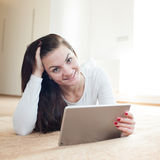 Beautiful young woman with tablet computer Stock Photo