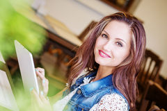 Beautiful young woman with tablet Royalty Free Stock Photography