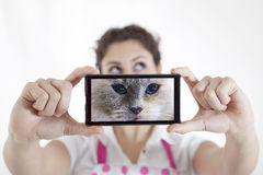 Beautiful young woman takes a selfie Stock Photography