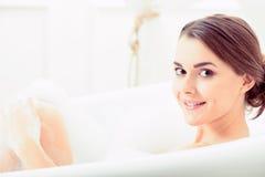 Beautiful young woman taking a bath Stock Image