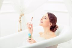 Beautiful young woman taking a bath Stock Image