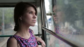 Beautiful young woman taking bus to work. Beautiful young woman taking trolleybus to work stock video footage