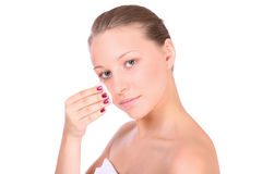 A beautiful young woman taking care of her face Royalty Free Stock Images