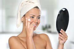 Beautiful young woman taking care of her skin Stock Photos