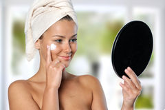 Beautiful young woman taking care of her skin Stock Photo