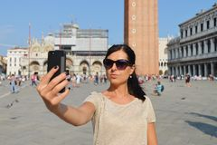 A beautiful young woman taking herself a selfie in Venice, Italy Stock Photos
