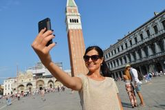 A beautiful young woman taking herself a selfie in Venice, Italy Stock Photography