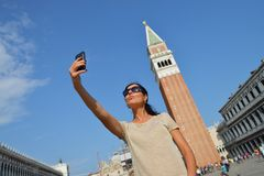 A beautiful young woman taking herself a selfie in Venice, Italy Stock Images