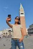 A beautiful young woman taking herself a selfie in Venice, Italy Royalty Free Stock Photos
