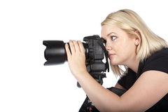 Beautiful Young Woman Taking a Picture. Beautiful Young Female Photographer Taking a Photo with Camera on a Tripod Royalty Free Stock Photos