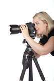 Beautiful Young Woman Taking a Picture. Beautiful Young Female Photographer Taking a Photo with Camera on a Tripod Stock Photos