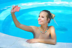 Beautiful young woman taking picture with cell phone Stock Photography