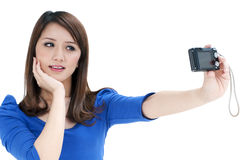 Beautiful young woman taking self portrait Stock Image
