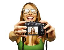 Beautiful young woman taking self portrait royalty free stock image