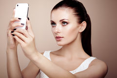 Beautiful young woman taking selfie Stock Images