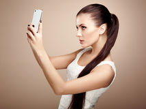 Beautiful young woman taking selfie Royalty Free Stock Photo
