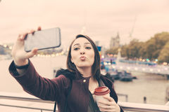 Beautiful young woman taking a selfie in London Royalty Free Stock Photography