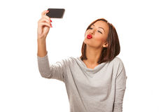 Beautiful young woman taking selfie. Stock Images