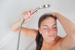 Beautiful young woman taking a shower. /hot bath tub and washing her hair Royalty Free Stock Images