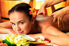 Pamper woman. Beautiful young woman taking spa treatments at the salon stock photos