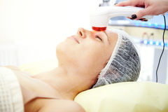 Beautiful young woman taking treatment royalty free stock photos