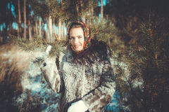 Beautiful young woman taking a walk through the pine forest Stock Images