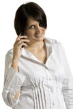 Beautiful young woman talking on cellphone Stock Photos