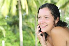 Beautiful young woman talking on cellphone Royalty Free Stock Photo