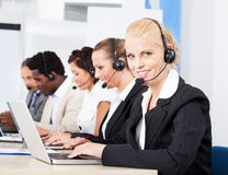 Beautiful young woman talking on headset Royalty Free Stock Image