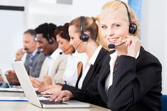 Beautiful young woman talking on headset Stock Photography