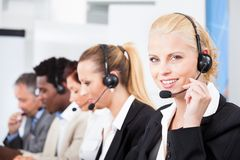 Beautiful young woman talking on headset Stock Image