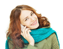 Beautiful young woman talking on a mobile phone Royalty Free Stock Images