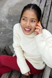 Beautiful young woman talking on mobile phone outdoors Royalty Free Stock Images