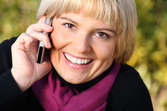 Beautiful young woman talking on the phone Stock Photography