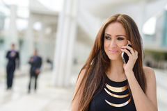 Beautiful young woman talking on phone Stock Photography