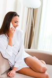 Beautiful young woman talking on the phone Stock Images
