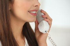 Beautiful young woman talking by telephone,. Closeup royalty free stock images