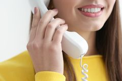 Beautiful young woman talking by telephone,. Closeup royalty free stock photography